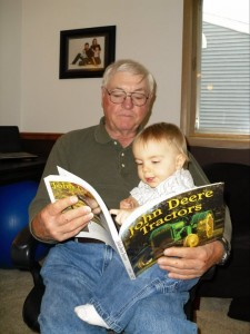 Grandpa Bob & Grandson Eli share a love of books and  tractors.